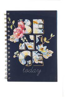 Cuaderno A5 espiralado con tapa blanda y 80 hojas rayadas. -